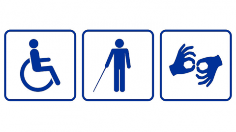 Three signs displaying accessibility symbols