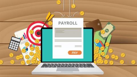 Laptop displaying payroll report