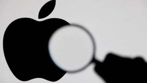 apple logo with magnifying glass