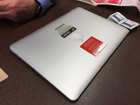 laptop with stop tag