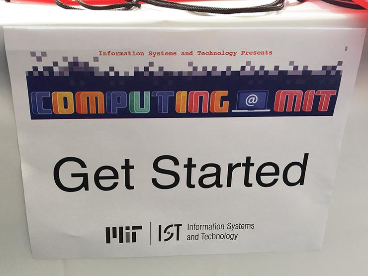 "SIgn taped to a table saying ""Get Started"" along with Computing @ MIT and MIT IS&T logos."